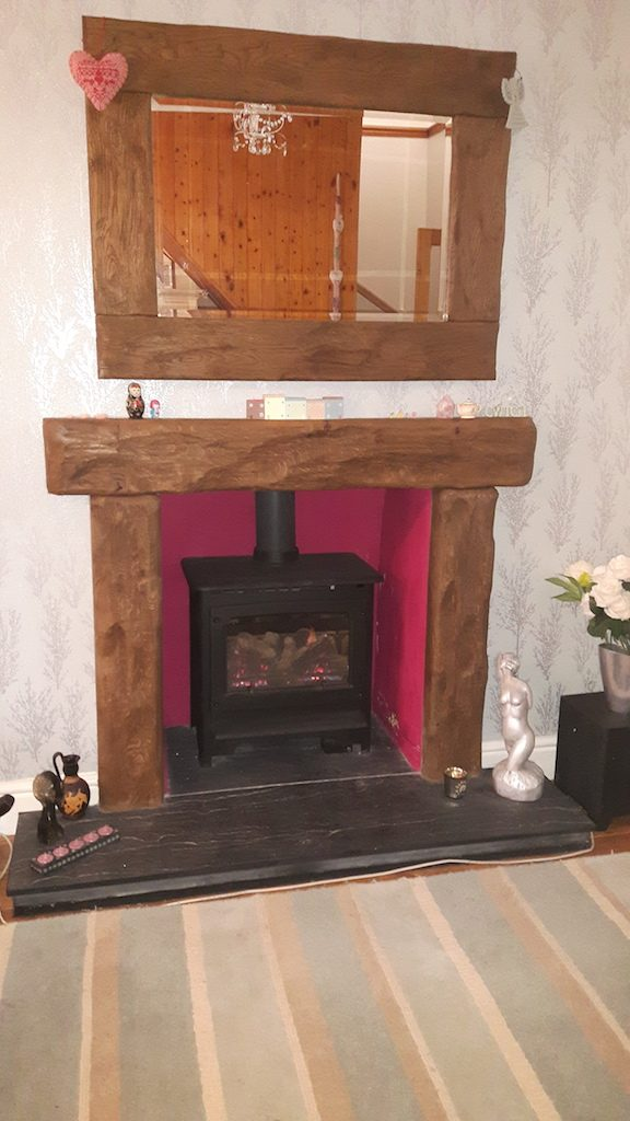 Gazco Gas stove with aged rustic oak surround and mirror