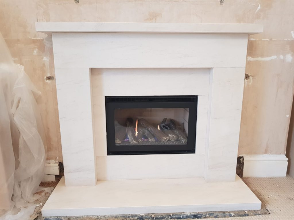 Crystal fires with Limestone Fireplace